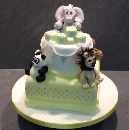 Christening or birthday cake with Elephant, Panda, Lion and a teddy on a 2 tier cake