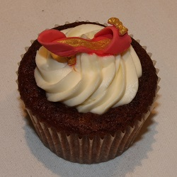 Red velvet cupcake with red and gold shoe