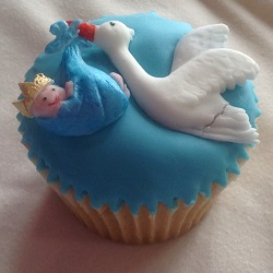 Stork flying with baby cupcake